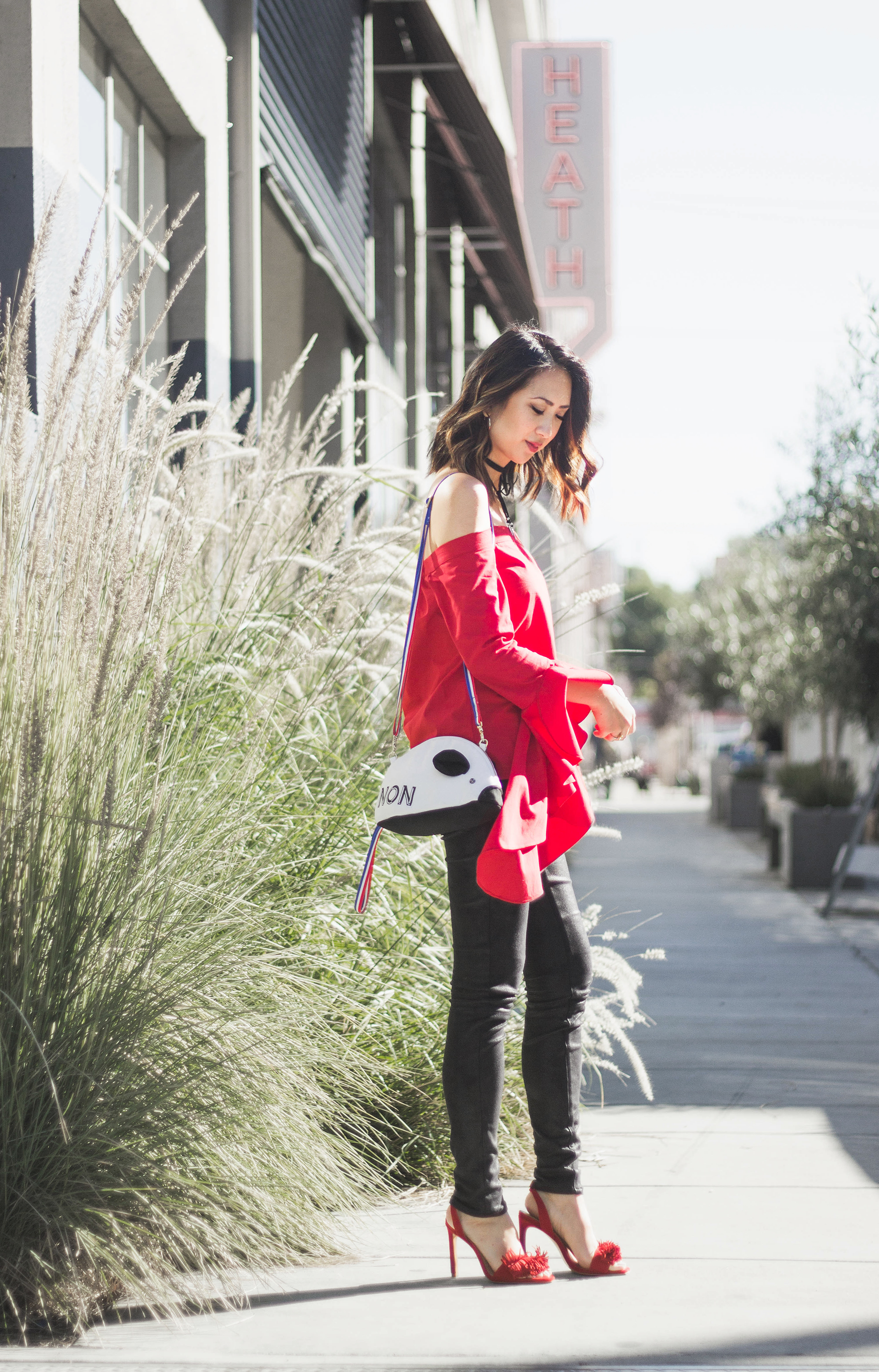 red off the shoulder top patricia chang french mouse bag